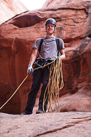 abseil: A young man explores a technical slot canyon in northern Arizona, USA Stock Photo