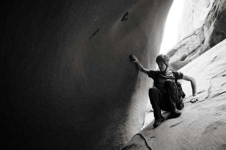 A young man explores a technical slot canyon in northern Arizona, USA Archivio Fotografico