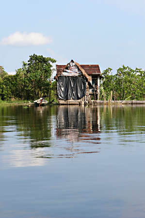 rise above: Houses on stilts rise above Amazon River Basin near Iquitos, Peru Stock Photo