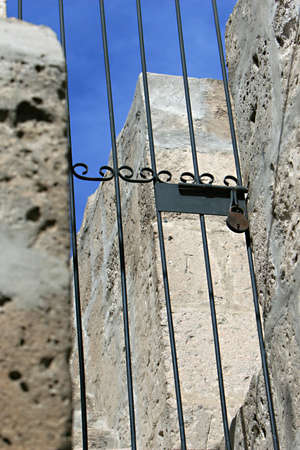 keepout: Old style padlock and gate inside the ancient Santa Catalina convent in Arequipa, Peru Stock Photo