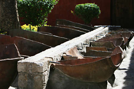 Open air laundry in Santa Catalina Monastery, Arequipa, Peru. A Stone trough sends the water to wash tubs made of split amphorae