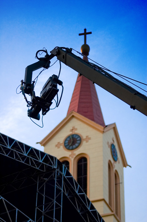 TV camera on the crane and with the church in the background photo
