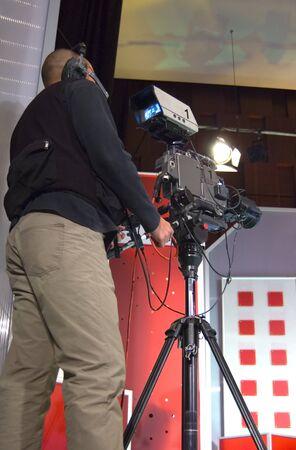 Cameraman works in the studio