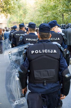 riots: Special police forces cordon at the demonstration blocking street protests Stock Photo