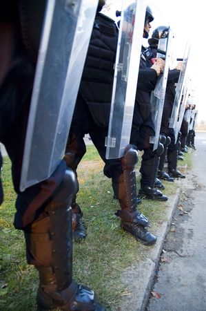 Special police forces cordon at the demonstration blocking street protests Stock Photo