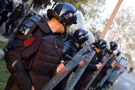 a watchman: Special police forces cordon at the demonstration blocking street protests Stock Photo