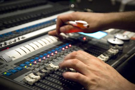 Finger control on film light mixing console
