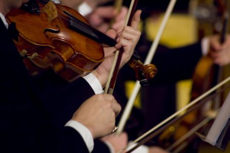 the symphony: A night at the symphony concert - playing violins Stock Photo
