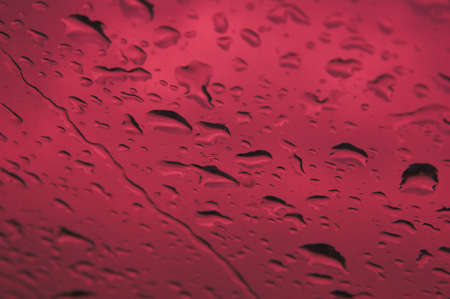 rain window: Rain drops on window with red background