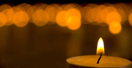 steadily: Candles on black background