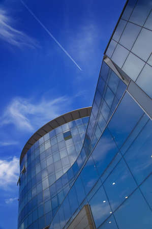 High modern building on a background of the blue sky