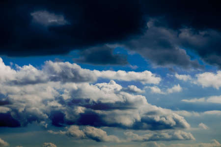 Beautiful clouds on the blue sky - bring the rain photo