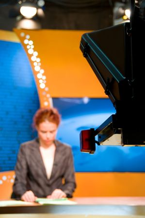 Young woman TV reporter presenting the news