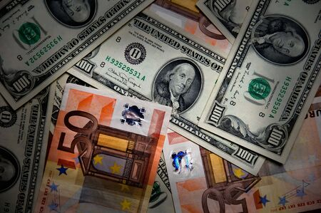 Euros and Dollars - International paper money close up Stock Photo