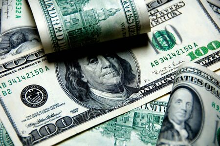 medium closeup: Money background of one hundred dollars $100 bills in US currency Stock Photo