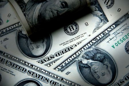 Money background of one hundred dollars $100 bills in US currency photo