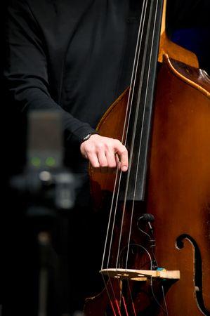 virtuoso: Acoustic double bass player - Classic Jazz Stock Photo