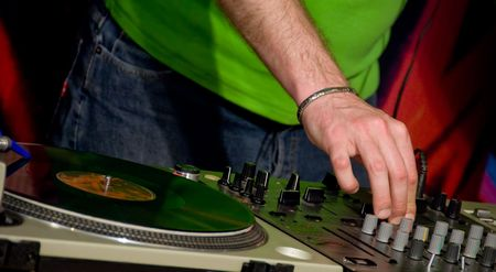 A detail of a gramophone disc with a DJ´s hand Stock Photo