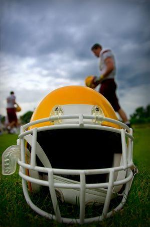 football helmet: American football helmet in grass