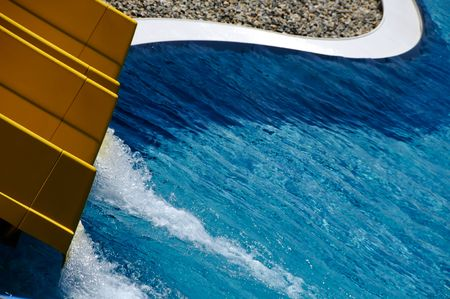Yellow water slide and swimming pool