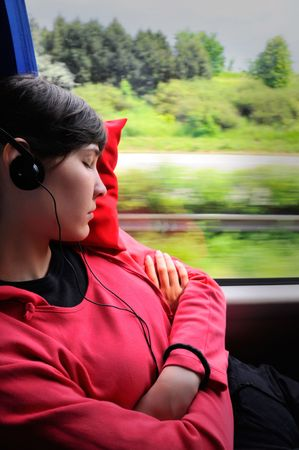 Travelling young woman - girl sleep in the bus
