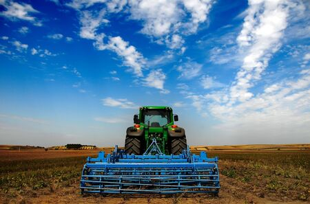 The Tractor - modern farm equipment in field                Stock Photo