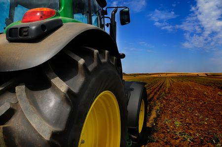 The Tractor - modern farm equipment in field                photo