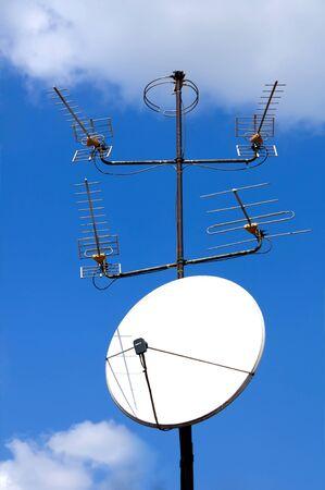 Satelite dish on blue sky background Stock Photo