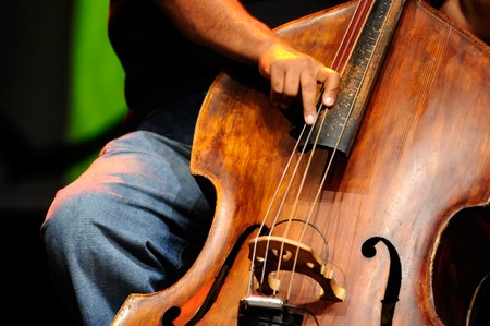virtuoso: Acoustic double bass player - Classic Jazz     Stock Photo