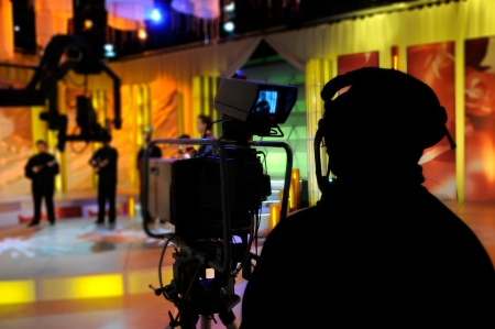 camcorder: Cameraman works in the studio - recording show in TV studio Stock Photo