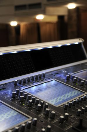 Audio mixing board with several channels and push sliding buttons