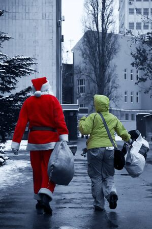 Santa Claus on the streets and carries the bag with gifts photo