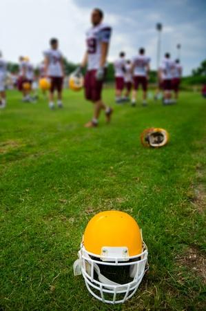 American football helmet in grass  photo