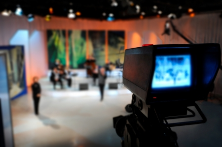 back to camera: Video camera viewfinder - recording in TV studio Stock Photo