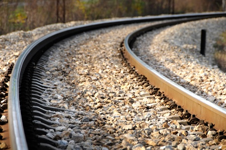 diverging: Railroad tracks in nature        Stock Photo