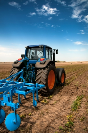 agriculture machinery: The Tractor - modern farm equipment in field  Stock Photo