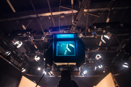 Video camera viewfinder - recording show in TV studio - focus on camera Stock Photo - 28384889