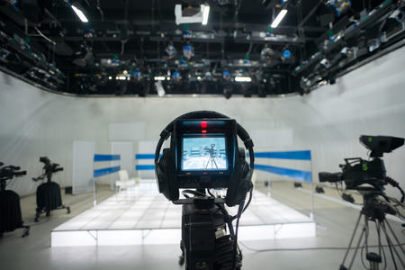 live action: Television studio with camera and lights
