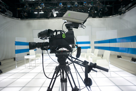 video production: Television studio with camera and lights