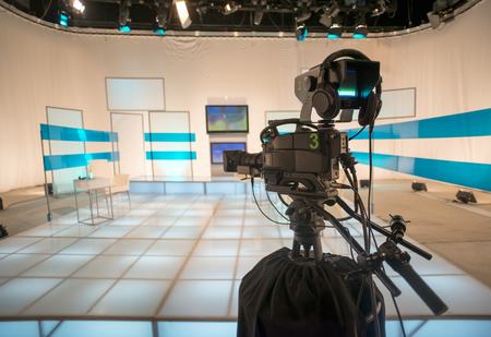 Television studio with camera and lights photo