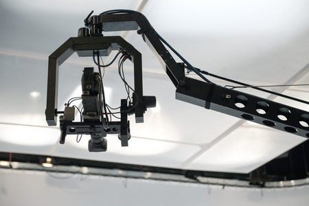 Television studio with jib camera and lights - camera on a crane photo
