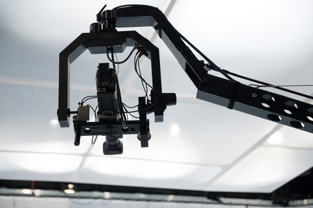 live action: Television studio with jib camera and lights - camera on a crane Stock Photo