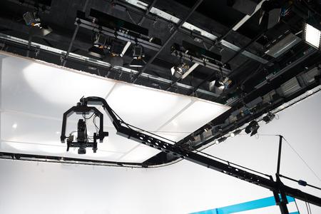 Television studio with jib camera and lights - camera on a crane Stock Photo