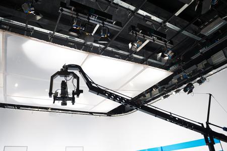 jib: Television studio with jib camera and lights - camera on a crane Stock Photo