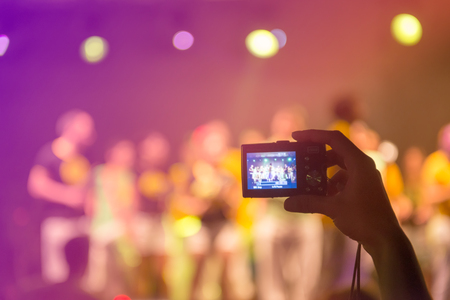 Taking picture at a music concert photo