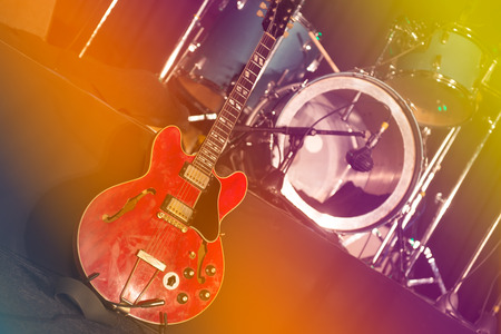 electric guitar: Guitar and drums on stage expect artists before the concert Stock Photo