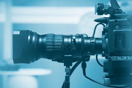 Professional video camera lens, recording TV show in studio