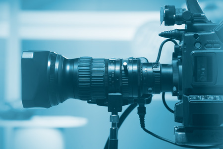cameras: Professional video camera lens, recording TV show in studio