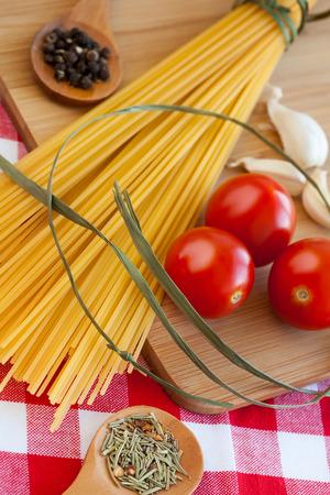 Food background, fresh vegetables, spaghetti, tomatoes, garlic, pepper, spice.