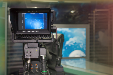 broadcasting: TV NEWS studio with camera and lights. Shallow depth of field - focus on camera.